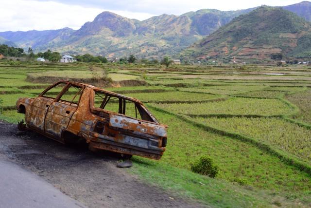 Derelict vehicles line the roads